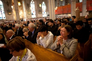 People attend the funeral mass for Cardinal Aloysius Ambrozic at St. Michael's Catholic Cathedral
